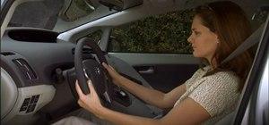 Adjust the steering wheel in the 2010 Toyota Prius