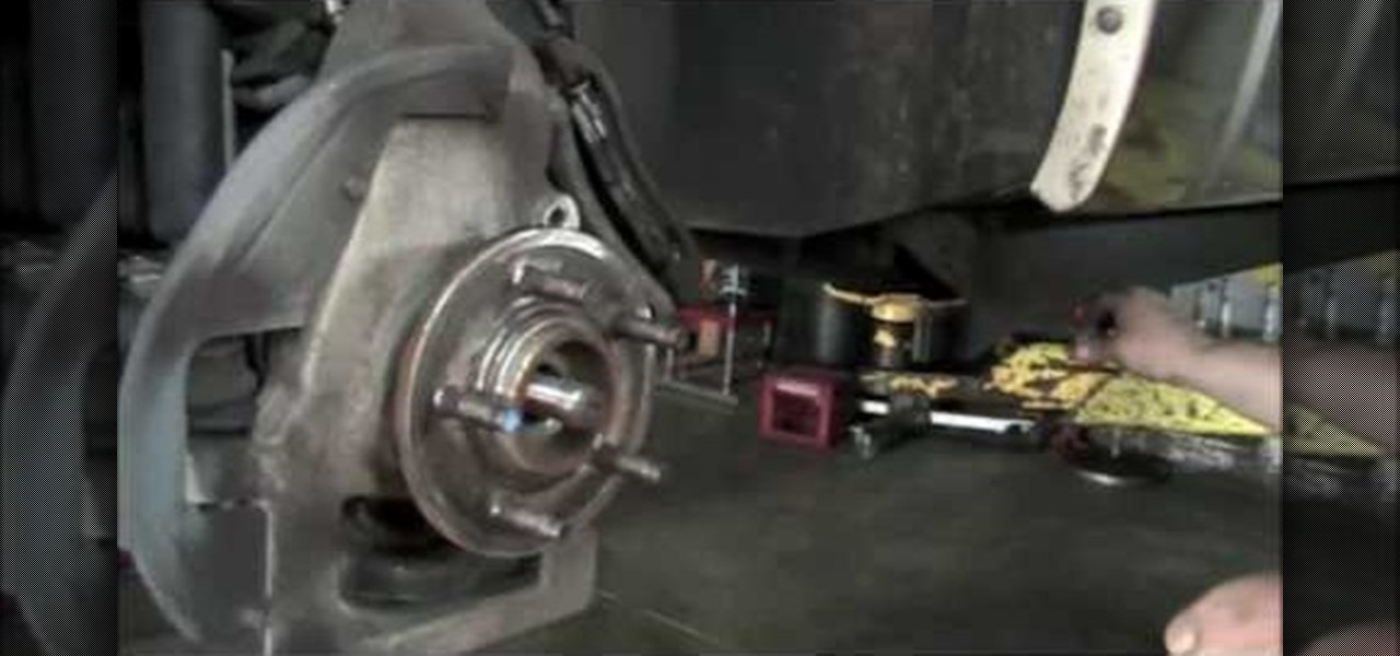 remove  replace  front wheel bearing    ford explorer auto maintenance