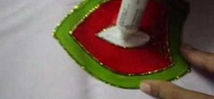 Paint a Rangoli design using glass paint