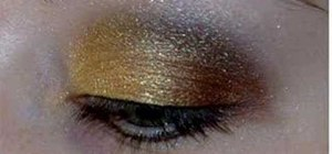Apply gold, brown and black eyeshadow