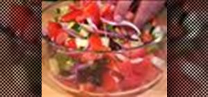 Makea Greek salad with feta cheese and olives