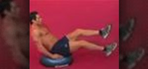 Exercise with the leg raise with scissor kick on bosu