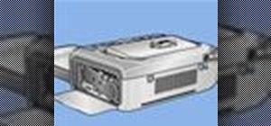 Load a cartridge into a Kodak G600 Printer Dock