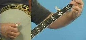 "Play""Blackberry Blossom"" on the banjo"