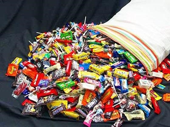 The Candy Hunter's Guide to Scoring Bigger, Better, & Boatloads of Sweet Treats on Halloween