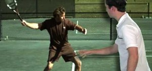 Practice a forehand swing to contact in tennis