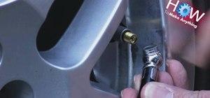 Use a tire gauge
