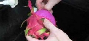 Peel a dragon fruit (also known as a pitahaya)