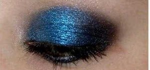 Apply dark blue and black eyeshadow