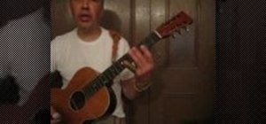 "Play ""Lonesome Atlanta Blues"" on slide guitar"