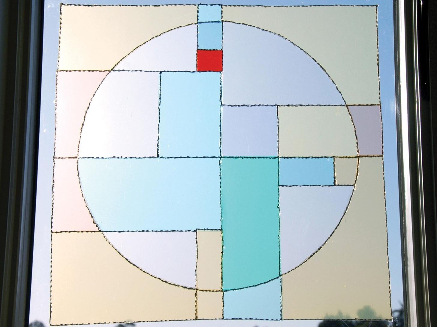 How to Turn a Boring Transparent Window into a Colorful Faux Stained Glass Masterpiece