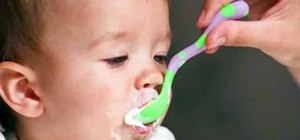 Start your baby on solid foods in her fourth or sixth month