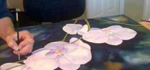 Paint orchid flowers with watercolor paints