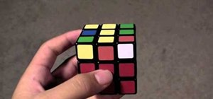 Turn and solve Rubik's Cubes one-handed faster