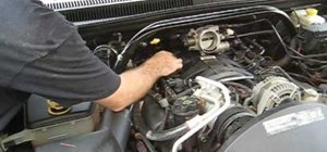 Change the spark plugs on a 4.7L V8 Jeep engine