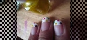 Paint rainbow dots on your nail tips