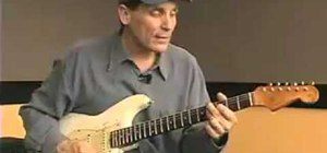 Play a sliding 9th chord on a blues guitar