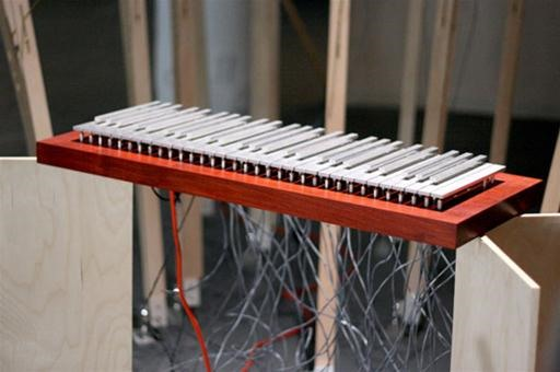 Sole Keyboard Conducts Orchestral Sculpture