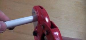 Cut plastic push-fit pipe