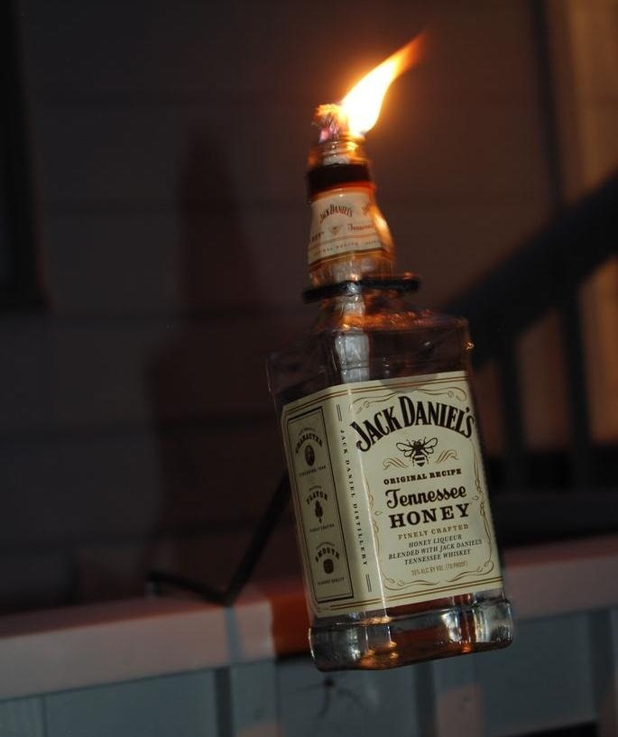 How to make a tiki torch from a bottle of jack daniels for Diy beer bottle tiki torches