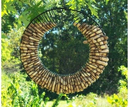 how to turn an old metal slinky and coat hanger into a bird feeder macgyverisms. Black Bedroom Furniture Sets. Home Design Ideas