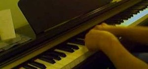 Play a blues song using four chords on the piano