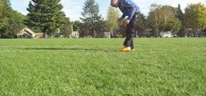 Execute a pushup stall freestyle soccer move