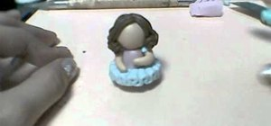 Make a little ballerina figure out of polymer clay