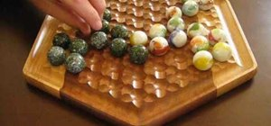 Play Marble Push on a hexagonal marble board