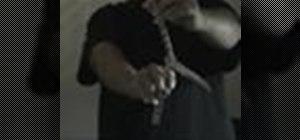 "Do a ""pinwheel"" balisong knife trick"