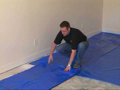 Install the moisture barrier over concrete subfloor