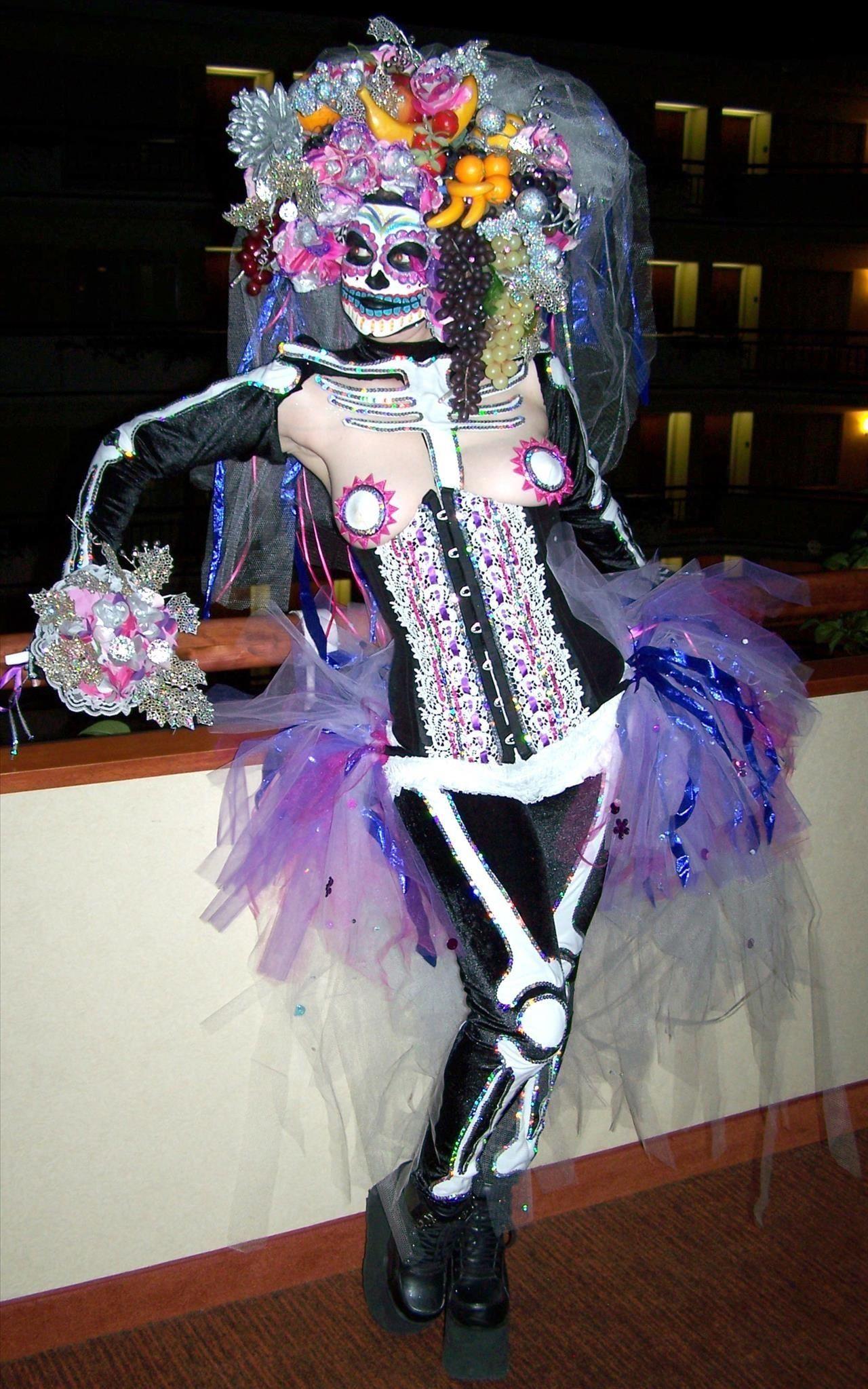I'm a Carmen Miranda/Sugar Skull mashup. I called it Dia de los Carmen. :)