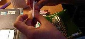 Roll a tobacco cigarette the old fashion way