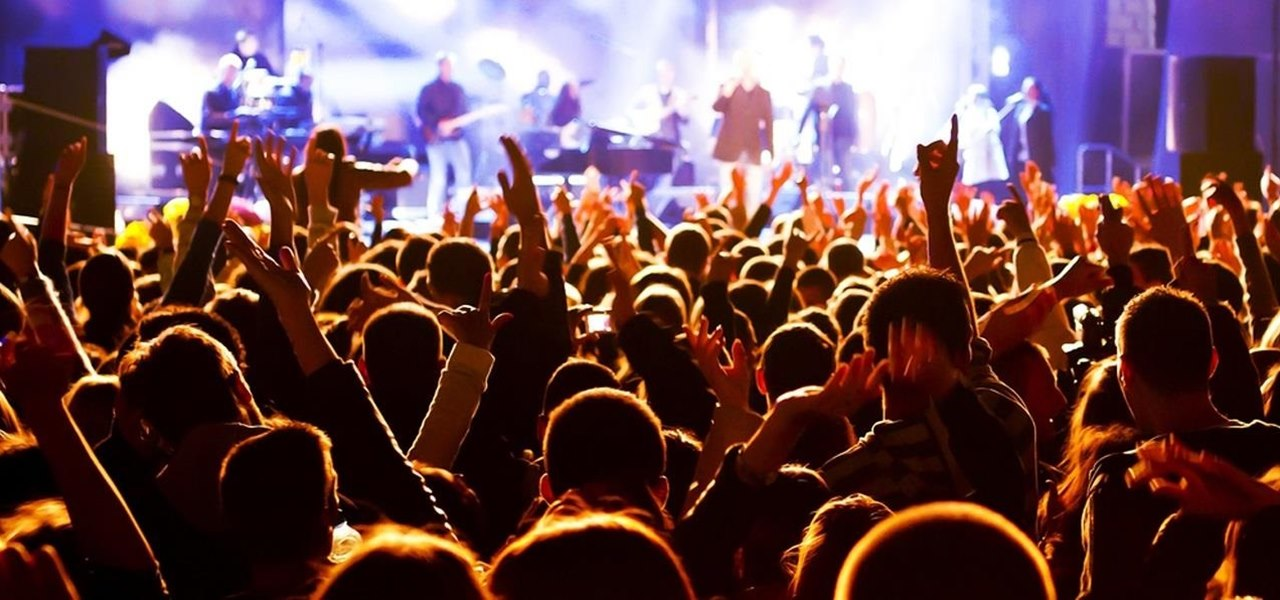The Trick to Hearing Your Friends Better at Loud Clubs & Concerts (And Having Them Hear You)