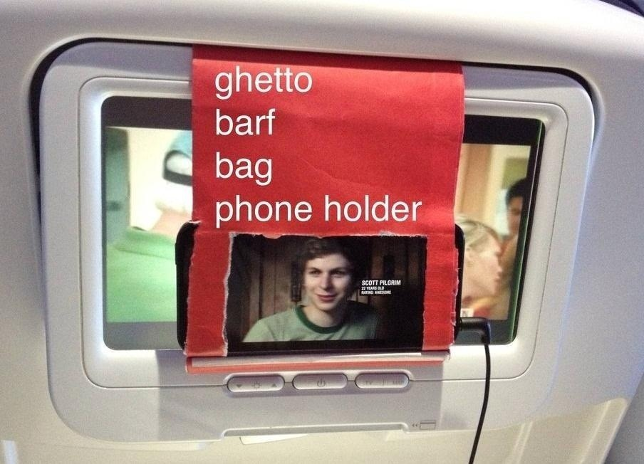 Next Time You Fly, Hack Your Barf Bag into a Smartphone Holder and Watch Your Own Movies