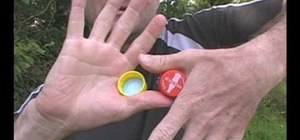 Do a bottle cap hand-swap trick