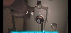 Install a drip leg in a gas powered hot water heater