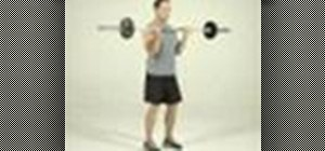 Tone arms with a standing barbell curl exercise