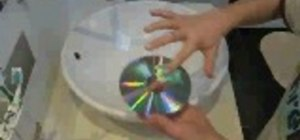 Clean a scratched CD or DVD with toothpaste