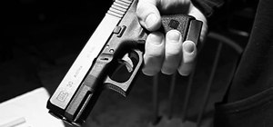 Use the trigger safety safely on a Glock handgun