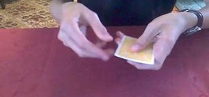 "Perform the ""Jumping Gemini"" card illusion"