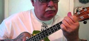 "Play ""Can You Feel the Love Tonight"" by Elton John on the ukulele"
