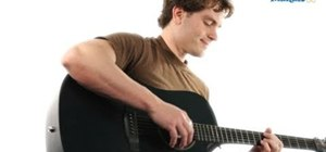 Play an A#m (A-sharp minor) chord on acoustic or electric guitar