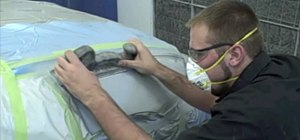 Block-sand a primer coat to prepare for auto body paint