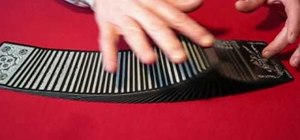 Perform the ribbon spread card flourishes