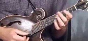 Tune a mandolin