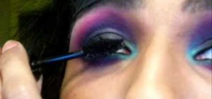 Do a black, fuchsia & blue makeup look with Petrilude