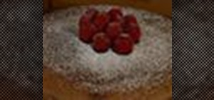 Bake a chocolate soufflé cake with strawberry topping