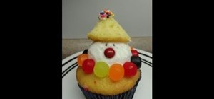 Decorate a cute, chubby clown cupcake