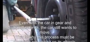 Remove a driveshaft hub nut on a front-wheel drive (FWD) vehicle